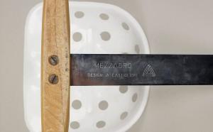 Mezzadro stool designed by Achille & Pier Castiglioni (1954).