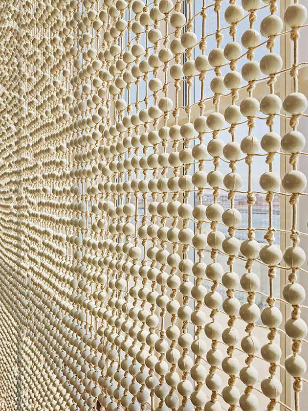 For the east facade Jongerius designed the Knots & Beads curtain, with hand-knotted yarn and 30,000 porcelain beads made from Dutch clay by Royal Tichelaar Makkum. Photo: Frank Oudeman.